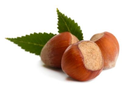 tasty  hazelnuts with leaves, isolated on white photo