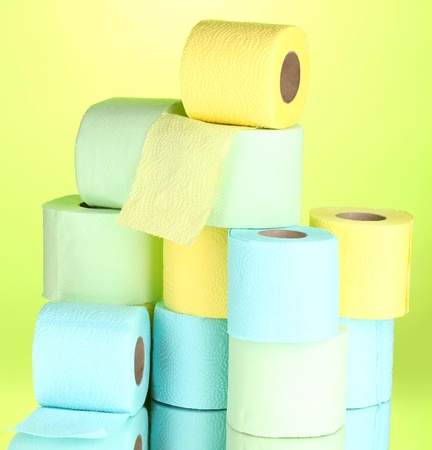 bright rolls of toilet paper on green background photo