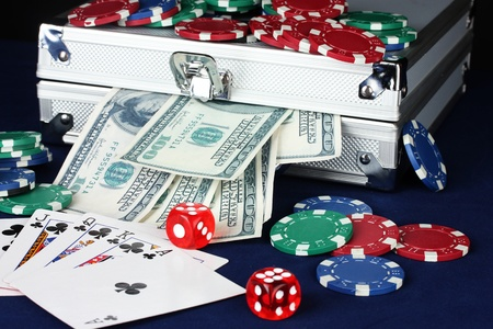 Suitcase with dollars on the blue poker table Stock Photo - 15729300