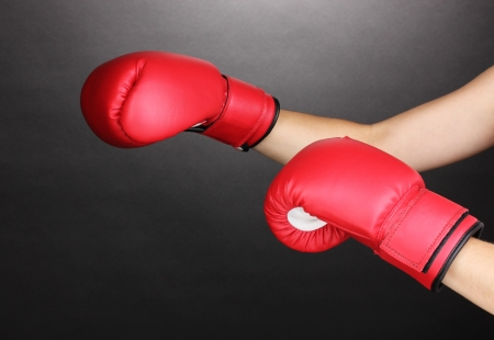 Red boxing gloves on hands on grey background Stock Photo - 15727181