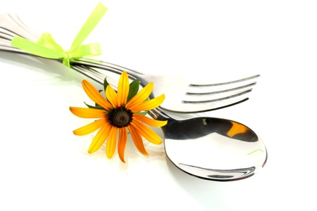 spoon, fork and flower, isolated on white photo
