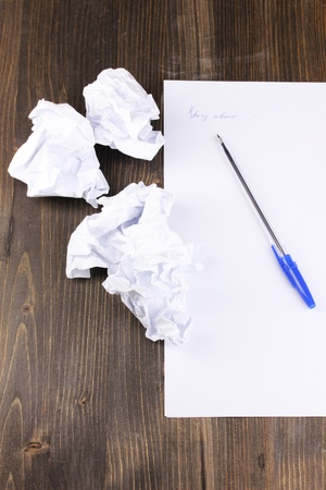 Creation of composition and crumpled sheets on wooden table Stock Photo - 15729356