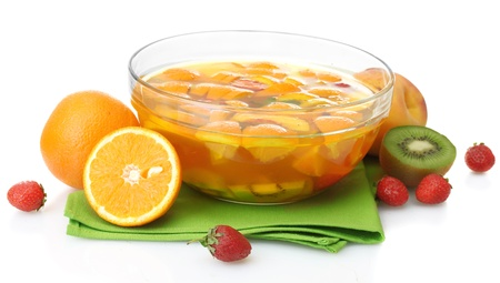 punch in glass bowl with fruits, isolated on white photo