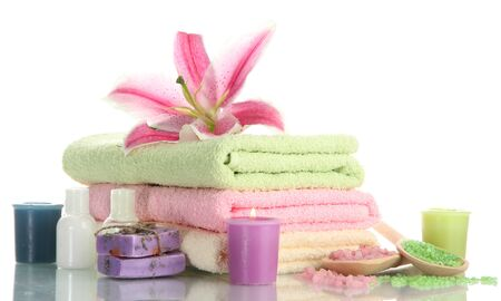 towels with lily, aroma oil,  candles, soap and sea salt isolated on white Stock Photo - 15725206