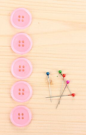 Colorful sewing buttons on wooden background photo