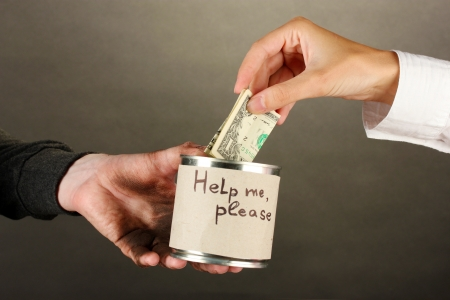 waster: helping the homeless, on black background close-up Stock Photo