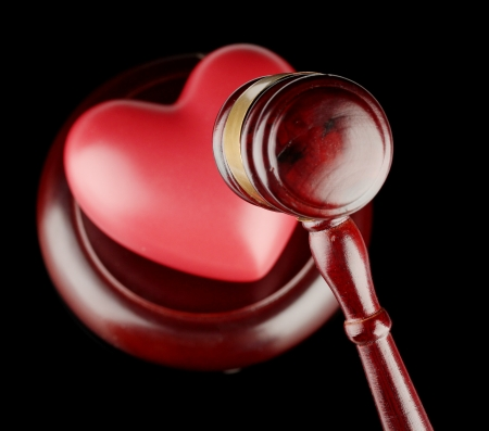 divorce court: concept of broken heart because of divorce, isolated on black Stock Photo