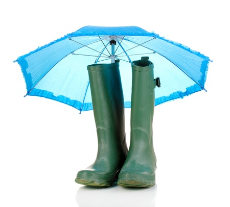gumboots: green gumboots and umbrella isolated on white