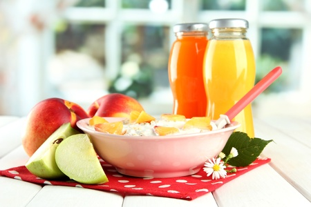 tasty dieting food and bottles of juice, on wooden table Stock Photo - 15727053