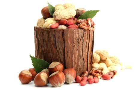 assortment of tasty nuts with leaves in wooden vase, isolated on white Stock Photo - 15726460