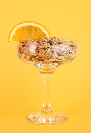 Lungs muesli in vase for desserts on yellow background Stock Photo - 15726520