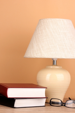 table lamp and books on beige background Stock Photo - 15729118