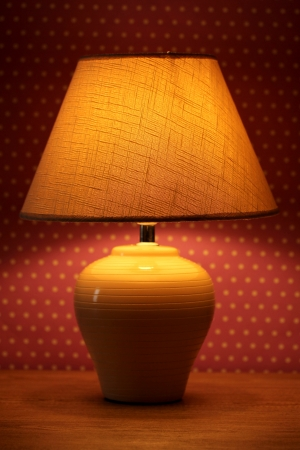 table lamp on wallpaper background Stock Photo - 15729454
