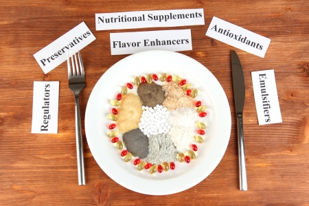stabilizers: Nutritional supplements on wooden background close-up Stock Photo