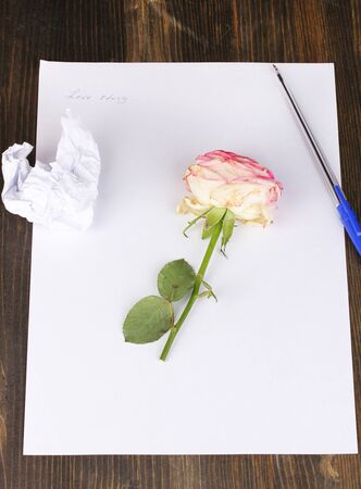 Creation of composition and crumpled sheets on wooden table Stock Photo - 15747061