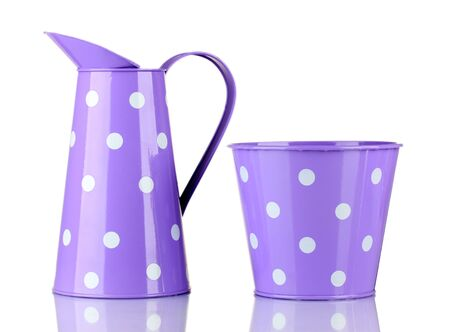 Purple buckets with white polka-dot isolated on white photo