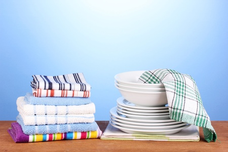 dishtowel: kitchen towels with dishes on blue background close-up