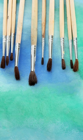 brushes on bright abstract gouache painted background Stock Photo - 15748132