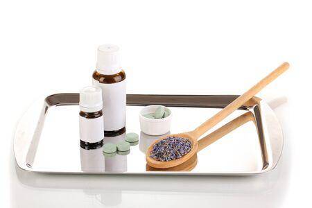 terapias alternativas: Las terapias alternativas en la bandeja de plata aislado en el fondo blanco close-up Foto de archivo