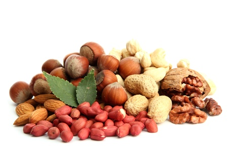 assortment of tasty nuts with leaves, isolated on white Stock Photo - 15745876