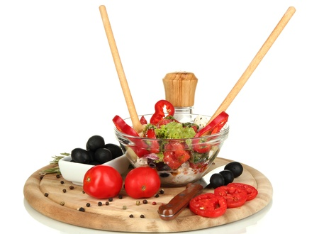 Fresh greek salad in glass bowl surrounded by ingredients for cooking isolated on white Stock Photo - 15743119