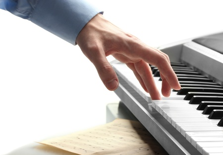 octave: hand of man playing piano Stock Photo