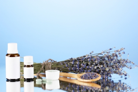 cures: bottles of medicines and herbs on blue background. concept of homeopathy