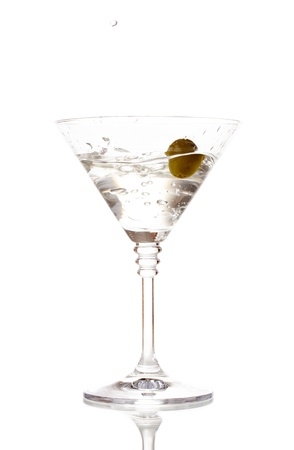 Martini glass with olive isolated on white photo