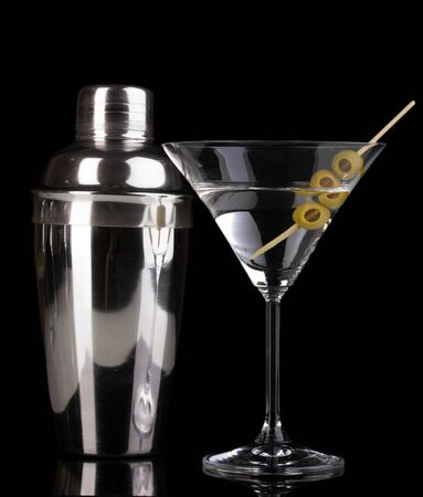 Martini glass with olives and shaker isolated on black Stock Photo - 15748968