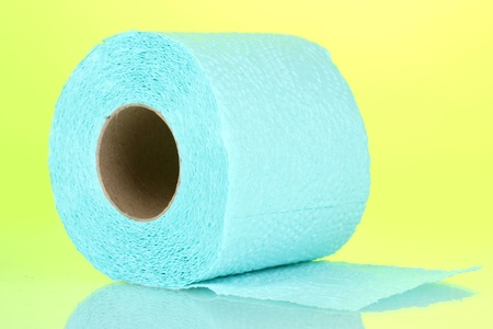 blue roll of toilet paper on green background photo