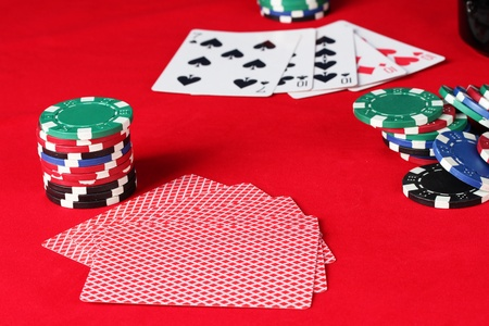 The red poker table with playing cards. A combination of four of a kind photo