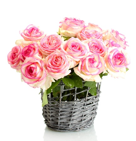 vases: beautiful bouquet of pink roses in wicker vase, isolated on white Stock Photo