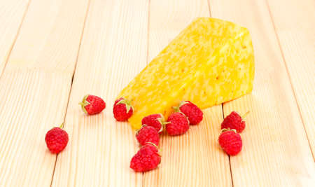 tasty cheese and berries on wooden background Stock Photo - 15781637