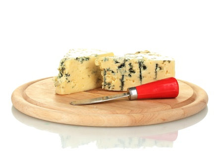 veined: Cheese with mold and knife on the cutting board isolated on white