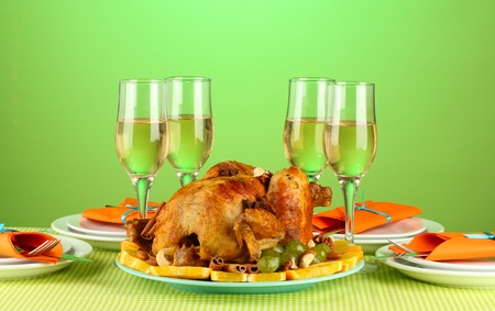 banquet table with roasted chicken on green background close-up. Thanksgiving Day photo