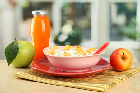 tasty dieting food and bottle of juice, on wooden table Stock Photo - 15782113