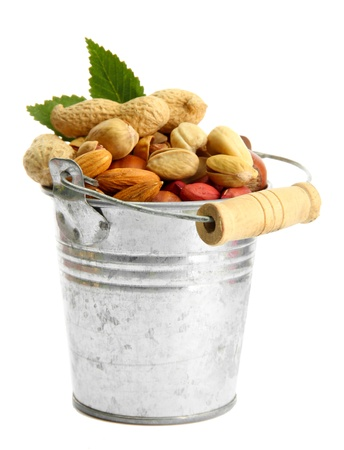 assortment of tasty nuts with leaves in pail, isolated on white Stock Photo - 15781245