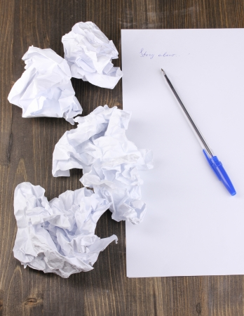 poem: Creation of composition and crumpled sheets on wooden table Stock Photo