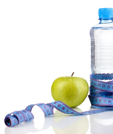 microelements: Bottle of water, apple and measuring tape isolated on white Stock Photo