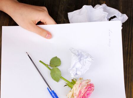 Creation of composition and crumpled sheets on wooden table Stock Photo - 15853518