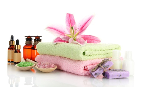 green bottle: towels with lily, aroma oil, soap and sea salt isolated on white