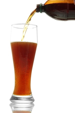 kvass poured into a glass, isolated on white Stock Photo - 15853158
