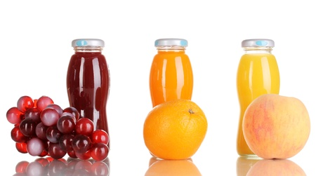 Delicious grapes, orange and apple juice in glass bottle and fruit next to it isolated on white Stock Photo - 15852716