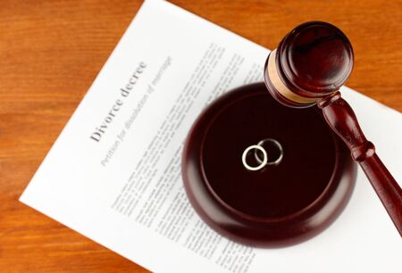 divorce court: Divorce decree and wooden gavel on wooden background Stock Photo