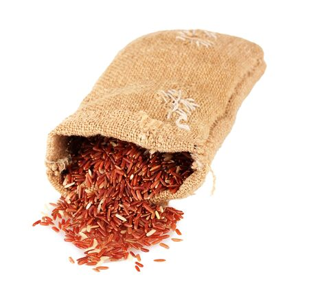 Cloth bag of red  rice isolated on white Stock Photo - 15853223
