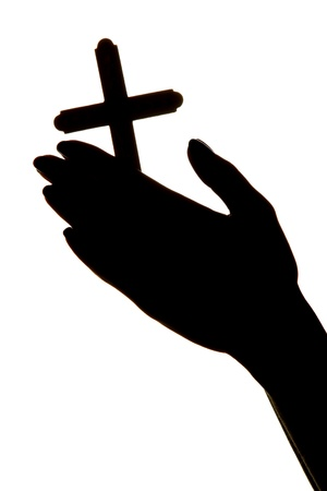 worship white: female hands with crucifix, isolated on white