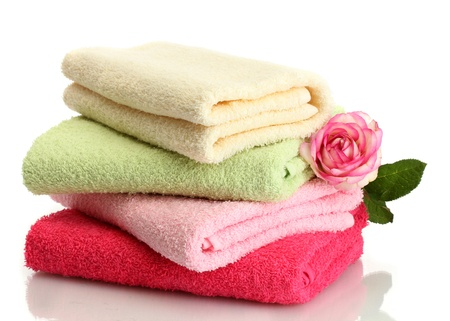 white towel: bright towels and rose isolated on white Stock Photo