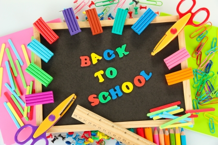 Small chalkboard with school supplies on white background. Back to School Stock Photo - 15938337