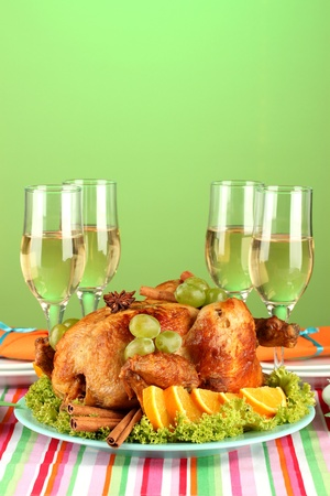 animal thanksgiving: banquet table with roast chicken on green background close-up. Thanksgiving Day