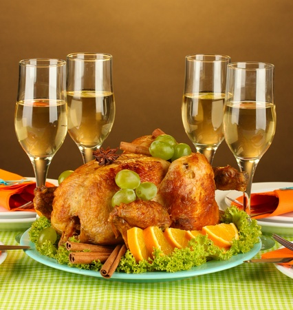 banquet table with roast chicken on brown background close-up. Thanksgiving Day photo